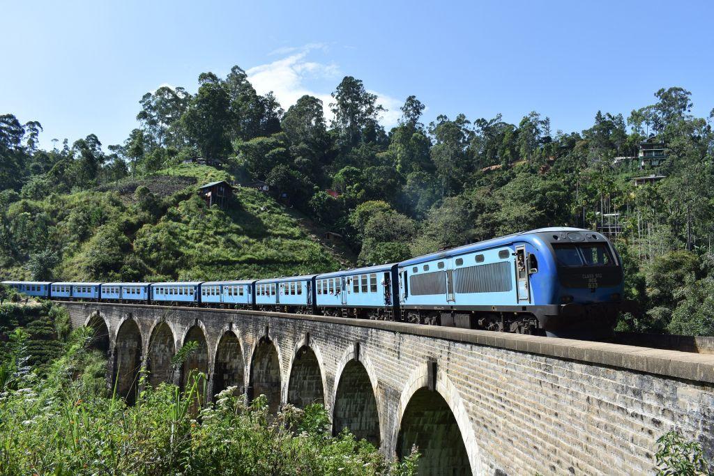 Blue train travelling over a bridge in Ella, Sri Lanka