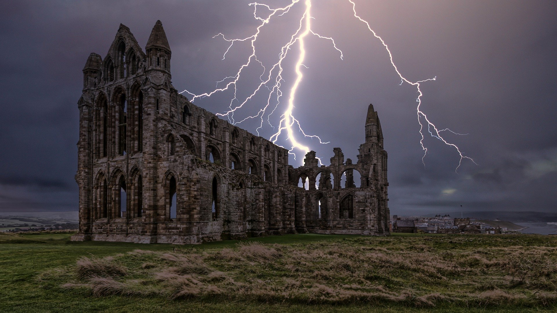 Whitby Abbey with a lightening strike behind it
